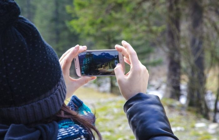 Women Taking Landscape Picture With Smartphone